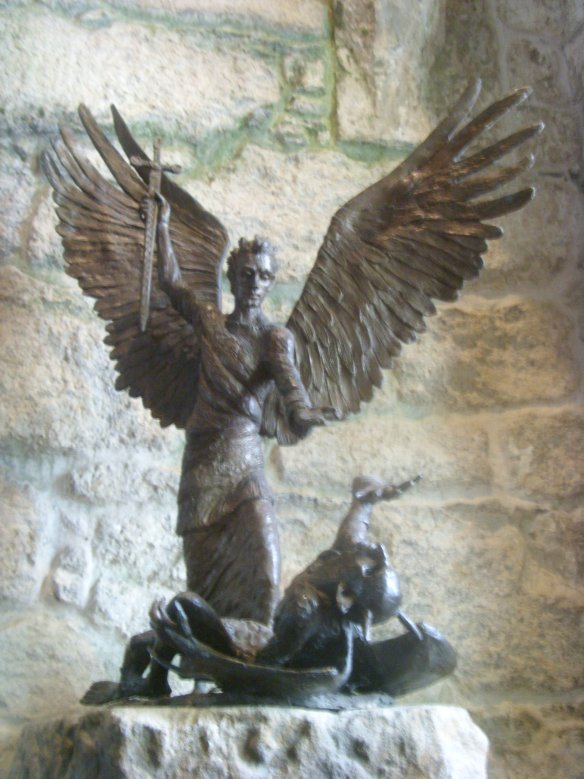 Archangel Michael defeating Satan.  Bronze inside the Mount's chapel.
