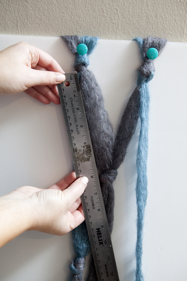 DIY easy grey and turquoise knotted scarf tutorial on SomethingTurquoise.com