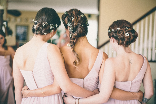 Beautiful bridesmaids with flowers in their hair