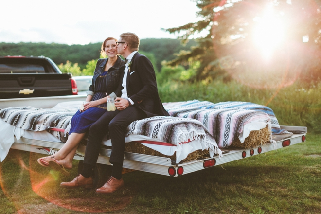 Bride and groom on wedding wagon