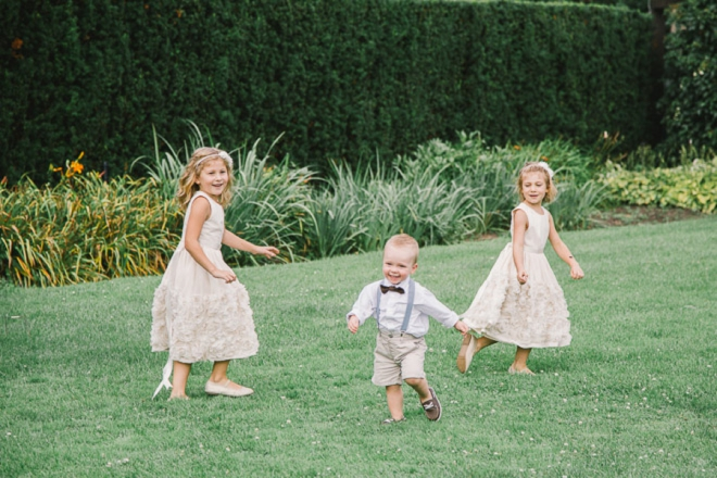 Flower girls and ring bearers playing
