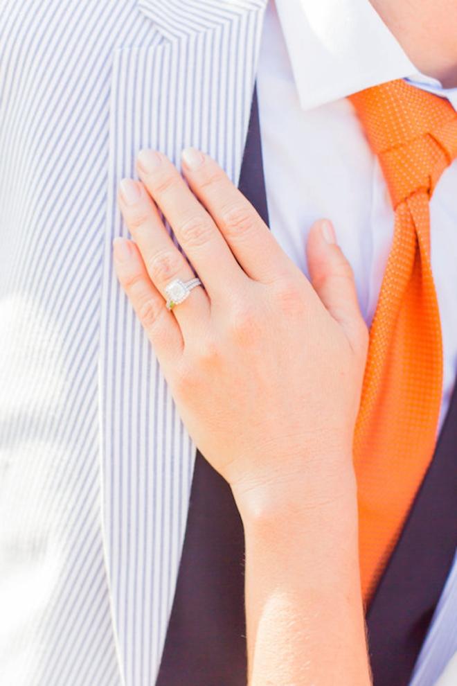 Wedding ring shot against grooms suit
