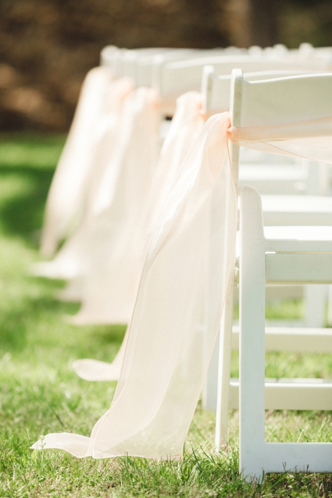 Chairs tied with beautiful soft pink bows
