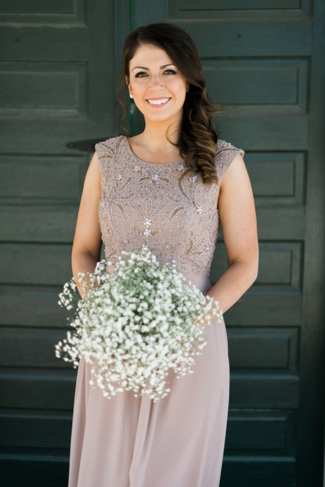 Maid of Honor with an all babies breath bouquet.