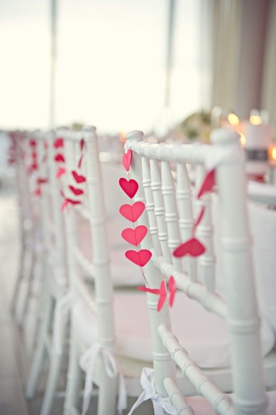 Just a little hint of romance with these darling chair garlands!