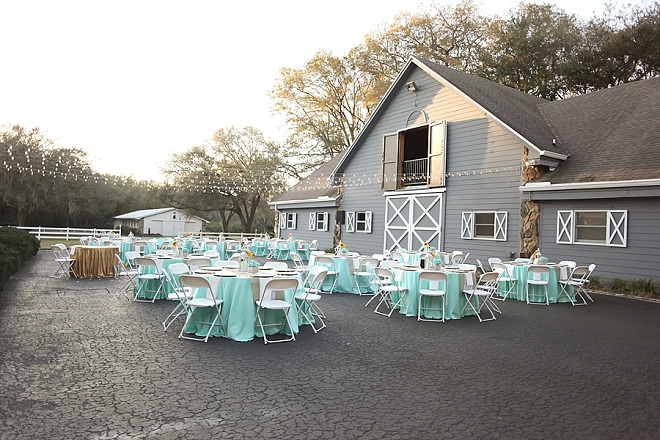 We love the turquoise pops of color at this rustic barn reception!