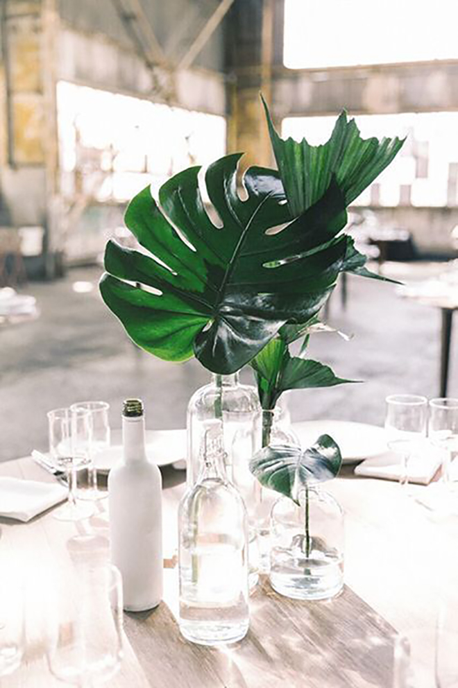 Simple monstera leaves make a lovely centerpiece.
