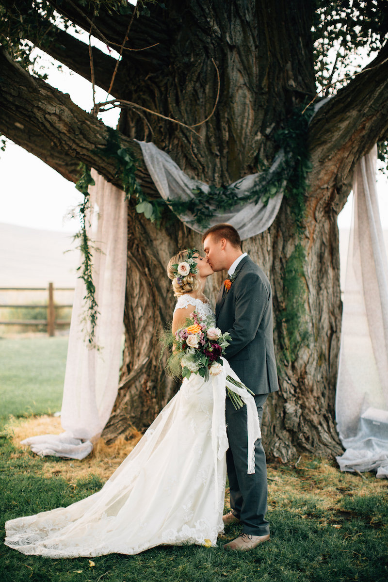 This fabric draping on the tree is such a simple way to decorate your wedding.