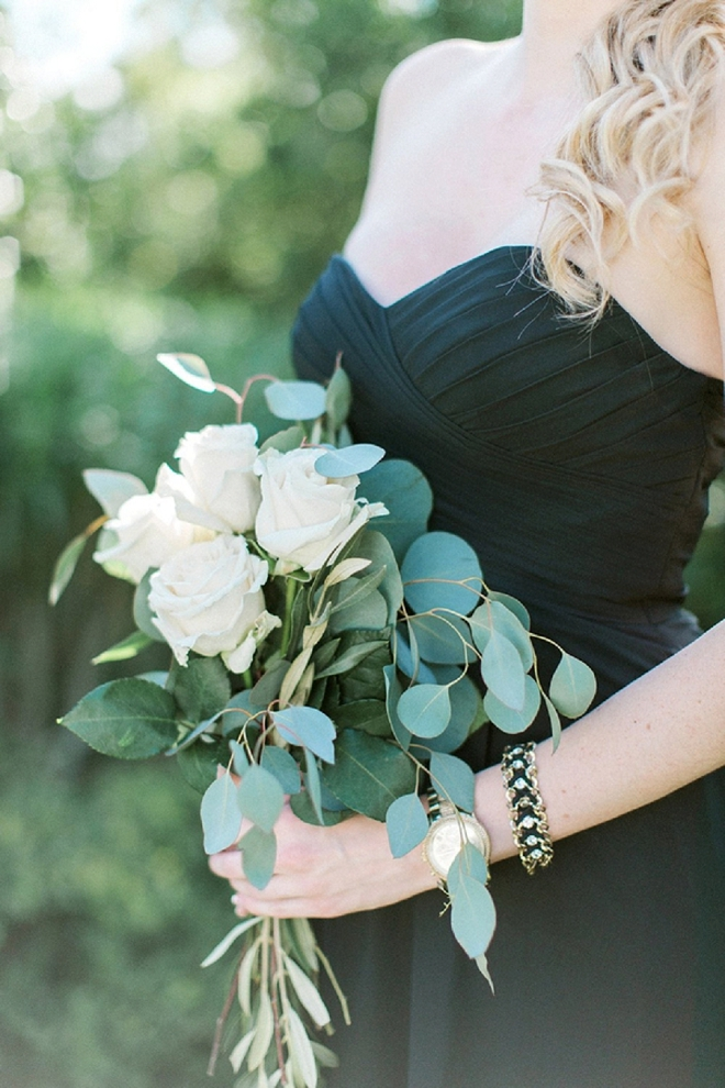 We're loving these Bridesmaid's style with black dresses and greenery bouquet!