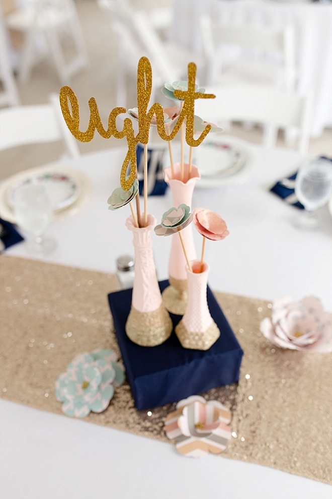 We're LOVING these gold glittery table numbers the Bride crafted!