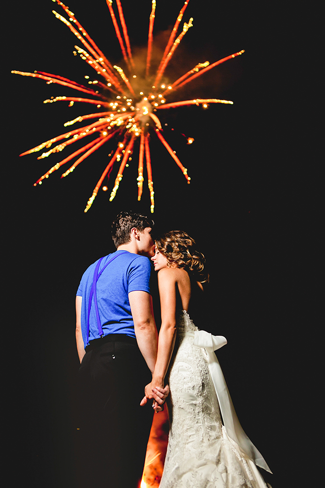 Gorgeous shot of a bride and groom during a firework show by George Street Photo & Video