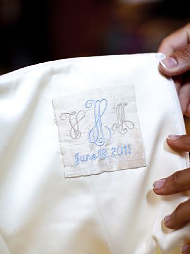 The inside of your gown is such a precious and personal place to add your wedding logo.