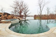 infinity pool, hot tub, and water slide