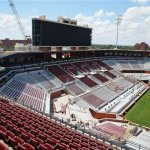 Work continues on renovations to the Gaylord Family - Oklahoma Memorial Stadium in Norman, Okla., Monday, Aug. 29, 2016. The work, which includes a new scoreboard and closing in the south end zone seating, is scheduled to be completed by the first home football game, Saturday, Sept. 10, 2016. (AP Photo/Sue Ogrocki)