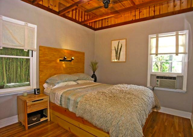 Bedroom with original wood floors and vaulted ceiling