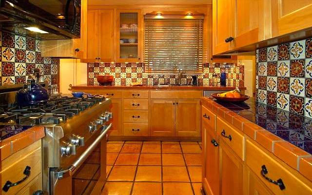 Kitchen with saltillo tile and professional-grade appliances