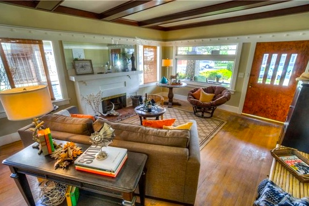 Living room with wood floors, box beamed ceilings and fireplace