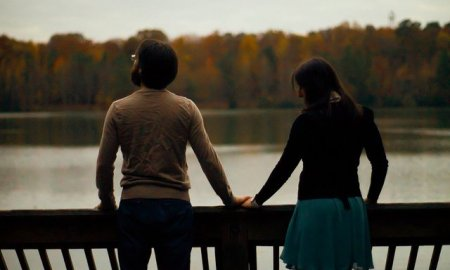 couple-distance-holding-hands-nature-river-love
