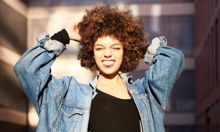 afro-woman-sticking-out-tongue