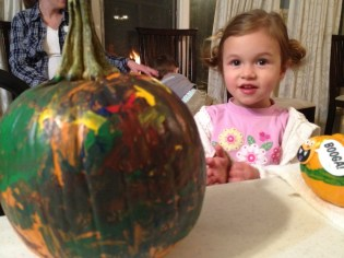 Here's Madeline and the pumpkin she painted.