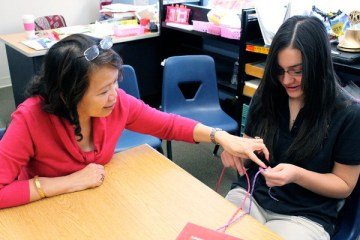 Heath Science teacher Mrs. Jocelyn Jaen carefully instructs sophomore Margaret Chang during a hand sutering lesson on Oct. 15.Photo Credit: Hailey Basner