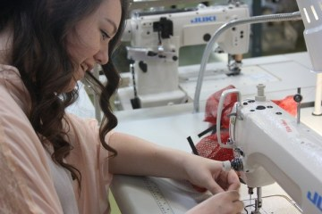 Senior Sarah Greenburg constructs her first garments for her product line.Photo Credit: Jenika Chiang