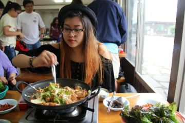 """unior Tamara Navarro eats at a local restaurant in South Korea. She visited South Korea this past summer. """"The food in South Korea was delicious. I'm already familiar with Korean cuisine, but to try authentic food was a completely different experience. The only downside is that now, the Korean food I eat here just isn't up to par anymore. For example the homemade Kimchi and the black haired pork just left me speechless, it was because of the freshness and the aesthetic preparation,"""" Navarro said.  Photo Credit: Tamara Navarro"""