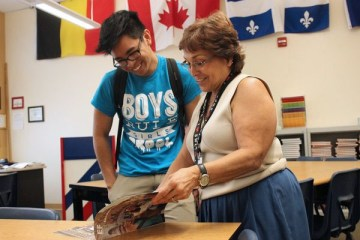 "Junior Earl Buenaflor speaks to Ms. Geri Barnish in regards to the foreign language trip. Students who are interested in attending may pick up informational packets and ask additional questions in Barnish's room (C100) or Mr. Mark Belanger's room. (C218). ""I am interested in going to Greece and Italy over the summer because I enjoy traveling and I have not yet been to Europe,"" Buenaflor said. Photo Credit: Tamara Navarro"