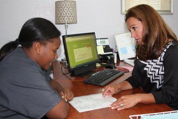 "At the counselor's office, Aundriana Gaston discusses possible summer school courses. Registration for summer school began April 6. ""I took history over the summer because I wanted to get ahead, so in my last year of high school, I could take college classes,"" junior Aundriana Gaston said. Photo Credit: Acel Soriano"
