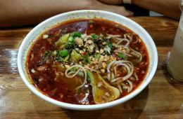 For $8, the Hot and Spicy Noodles lived up to their name nicely; the flavored red broth marinated the noodles and vegetables intensely. Photo Credit: Althea Gevero