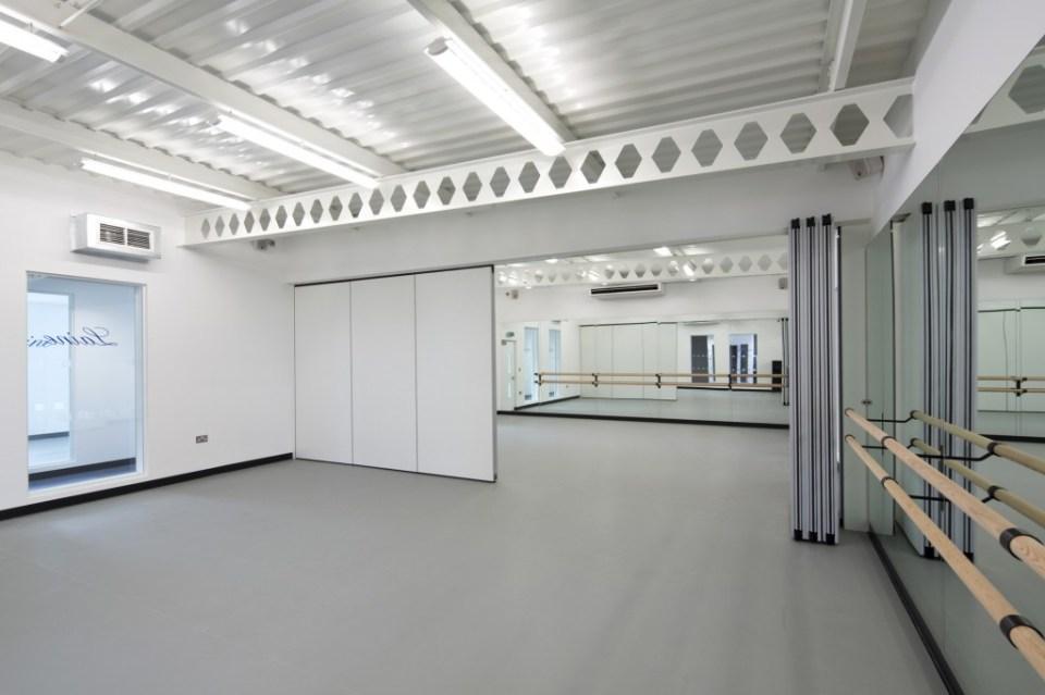Image of Laine Theatre Arts dance studio retractable full-height doors - half open