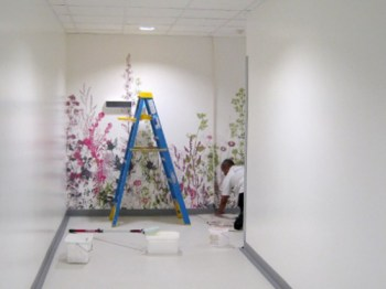 Picture of digitally printed wallpaper being installed into an office