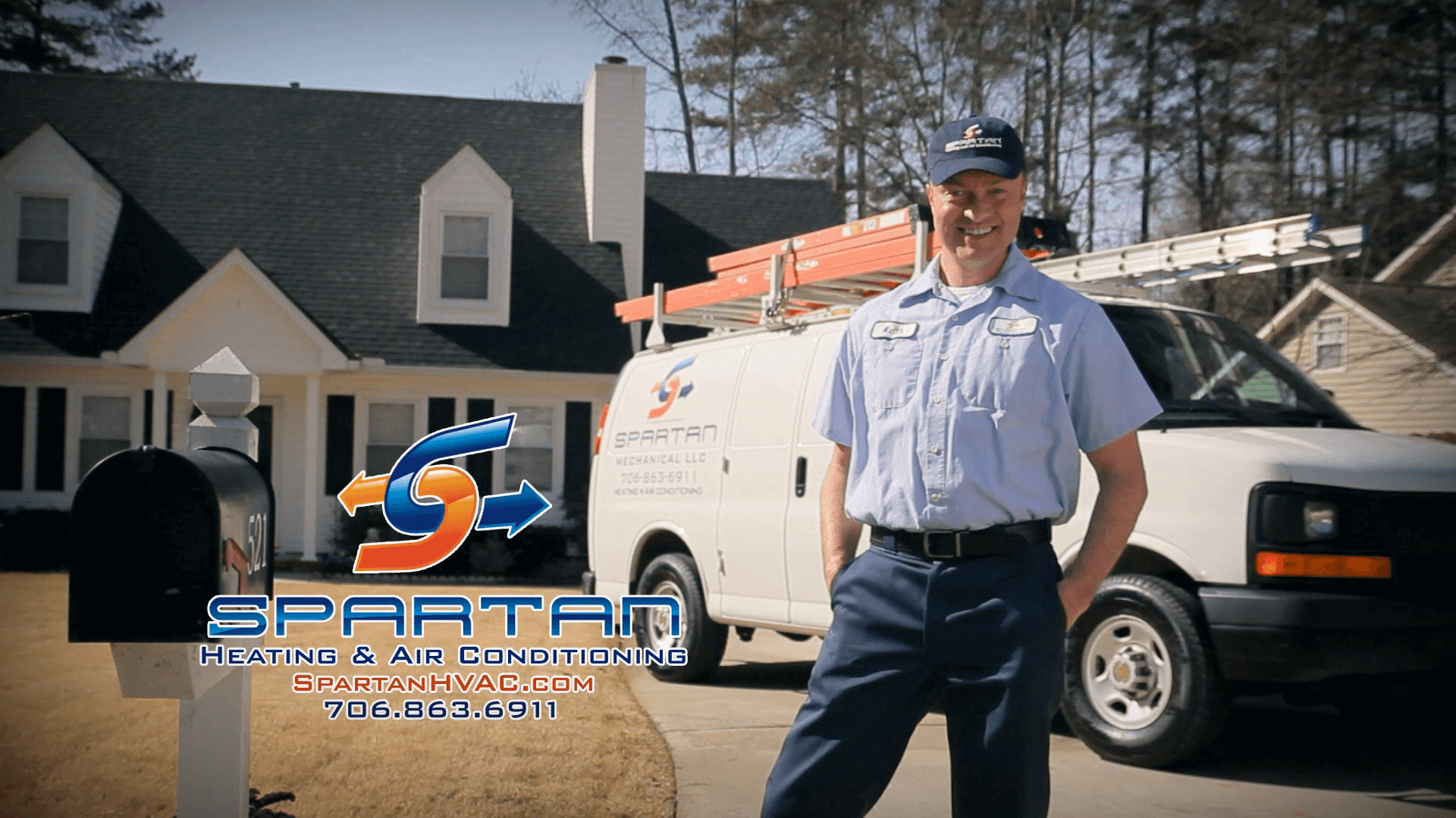 Spartan HVAC worker standing in from of van in driveway