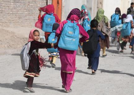 Children going home after school in Kandahar, in the southern region of Afghanistan, wearing their UNICEF backpacks.