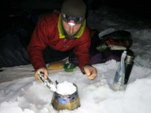 Shawn Forry preparing a hot meal on a winter traverse of the Pacific Crest Trail. Photo courtesy Justin Lichter, via PCTA.