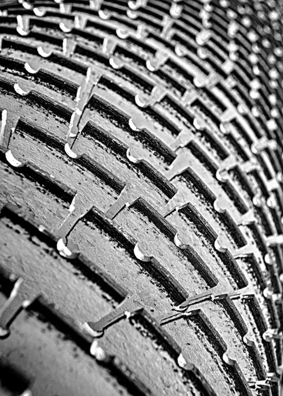 Closeup of a concrete saw used to cut rain grooves in the new roadway surface. Black and White Version #2