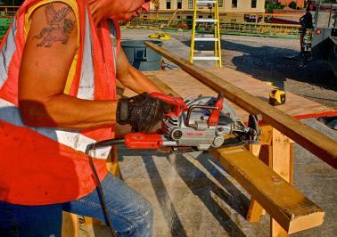 Carpenter's Apprentice, JoAnn, cutting 2 x 4 braces for concrete forms.