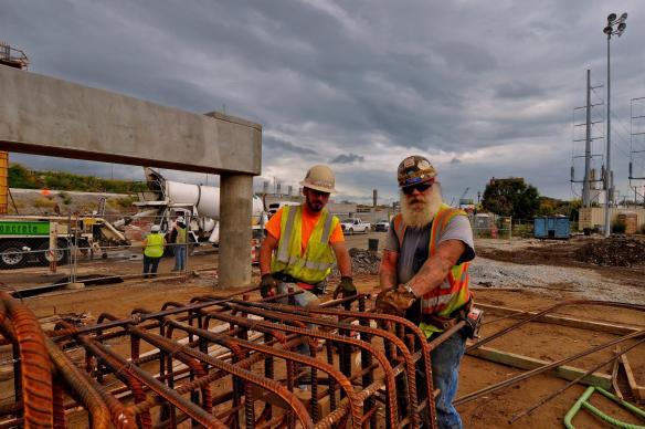 Slade Rock and Jimbo Clark tying rebar on the Ohio River Bridges Project.imbo Clark and Slade Rock tying rebar on the Ohio River Bridges Project.