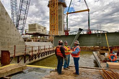 An unidentified Ironworker talks with Mike Haycraft and Brad Mires about the pick of the Edge Girder for Tower Five on the Ohio River Bridges Project. #2