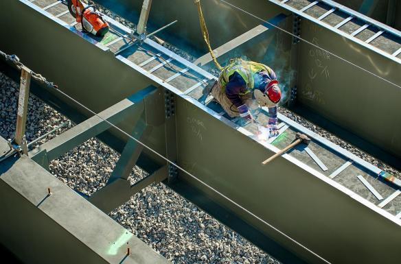 Ironworker welding on a bridge girder. #4
