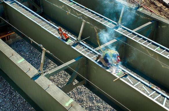 Ironworker welding on a bridge girder. #3
