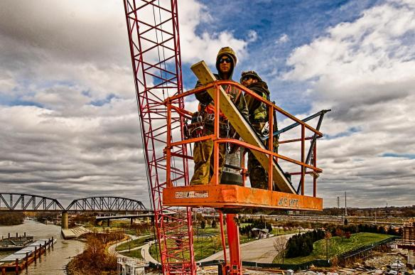 Carpenters Working On Tower Three West From an Aerial Lift.