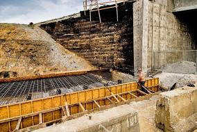 Russ Soldner inspects the work on a retaining wall base being built at Preston and Jefferson Streets in Louisville, KY.