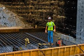 Brad Hall, Ironworker, Local 70 working on a mat for a retaining wall base at Preston Street and Jefferson Street in Louisville KY.