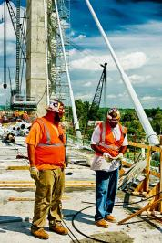 """Journeymen Jason """"Bouncer"""" Wells and Sean Ellery at work on the Downtown Span of the Ohio River Bridges Project in Louisville, KY. HDR Version"""