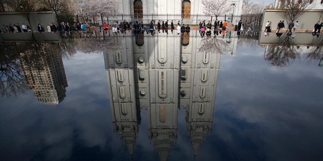 (RNS1-jan27) People walk past Salt Lake temple as they arrive to attend the biannual general conference of the Church of Jesus Christ of Latter-day Saints in Salt Lake City, Utah on April 5, 2014. For use only with RNS-MORMON-GAYS, transmitted on January 27, 2015, Photo courtesy of REUTERS/Jim Urquhart