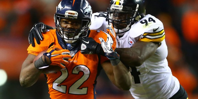Denver Broncos running back C.J. Anderson (22) runs against Pittsburgh Steelers inside linebacker Lawrence Timmons (94) during the fourth quarter of the AFC Divisional round playoff game at Sports Authority Field at Mile High in Denver, Colo., on Jan. 17, 2016. Photo by Mark J. Rebilas-USA TODAY, courtesy of REUTERS *Editors: This photo may only be republished with RNS-FOOTBALL-VIOLENCE, originally transmitted on Jan. 28, 2016.