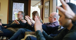 People praying/photo by Loren Kerns - Flickr