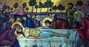 A mosaic depiction of Christ's body being prepared after his death, opposite the Stone of Anointing.