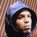 Still capture of Youtube video featuring Cam walking  out after listening to questions. (Chris Harris of the Denver Broncos can be heard bragging about their winning game plan in the background).